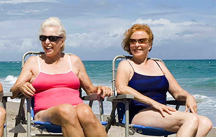 Why do varicose veins feel worse in the heat?